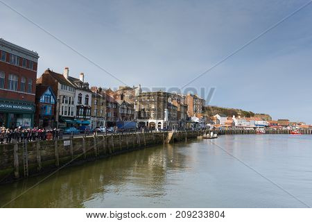 WHITBY, NORTH YORKSHIRE, ENGLAND, UK-FEBRUARY 21ST 2017: Fine calm winter weather was enjoyed by visitors to the harbour Whitby, North Yorkshire, on Tuesday 21st February 2017