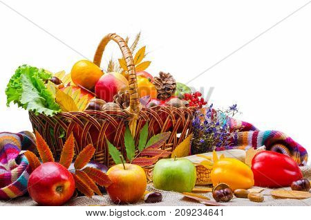 Vegetables And Fruit In A Wicker Basket, Isolated On White.