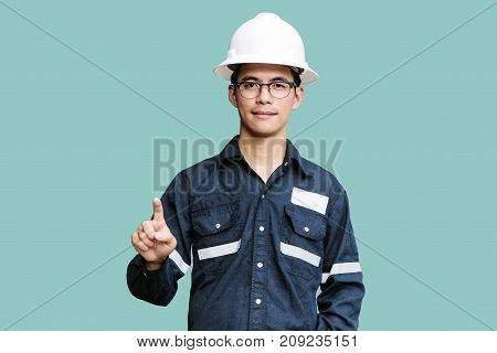 Asian manEngineer or Technician in white helmet glasses and blue working shirt suit Pointing the finger isolated on white mechanic and Oil and Gas industrial concept with clipping path.