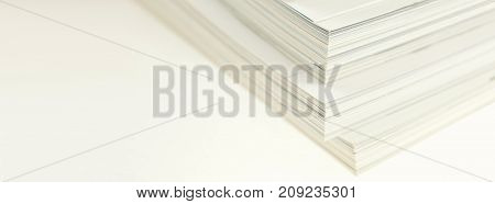 Stacked magazines on white background. Closeup Long wide banner with a copy space