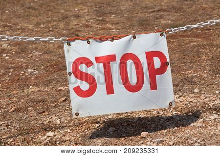 Stop sign restricting entry. Horizontal shot. sunny day