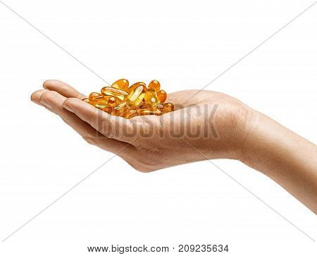 Many capsules Omega 3 in man's hand isolated on white background. Palm up. Close up. High resolution product. Health care concept