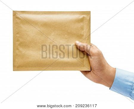 Man's hand in a shirt holds a yellow envelope isolated on white background. Close up. High resolution product