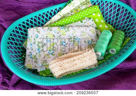 Green fabric, lace and thread in green box