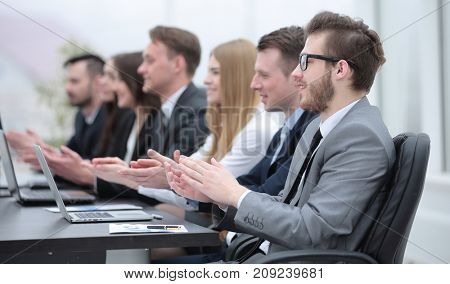 business team applauding the speaker at the meeting