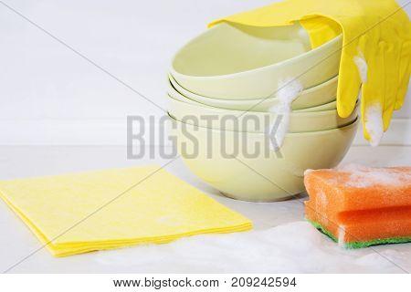 Several colorful plates kitchen sponges. Dishwasher concept