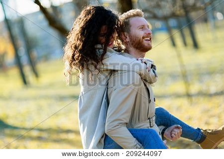 Young attractive couple having romantic date together in park