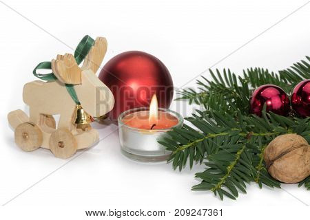 Christmas animal figure with candle and red balls against white background