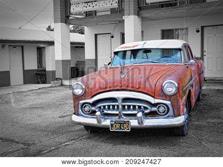 Seligman Arizona Usa - July 24 2017: Rusty abandoned Packard car in Seligman Arizona.