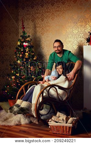 Happy family at home near christmas tree