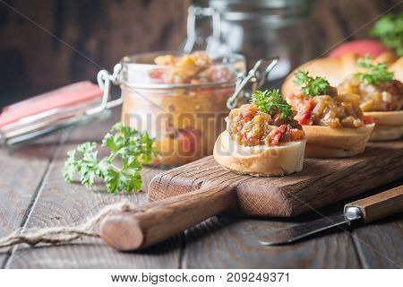 Bread toasts with eggplant caviar. Vegetable appetizer or antipasti. Healthy food for vegetarian