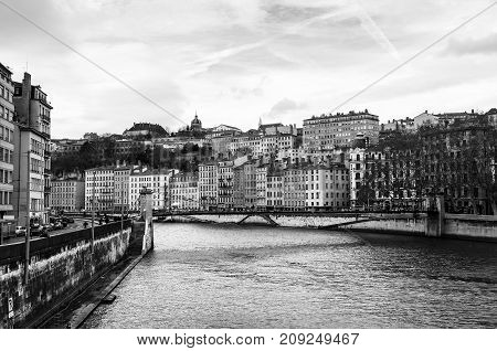 Lyon France. Aerial view of Lyon in autumn with River and Bridge France. Historical buildings with cloudy blue sky. Black and white