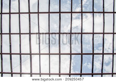 Bamboo grill pattern For roof Plant nursery Blue Sky background