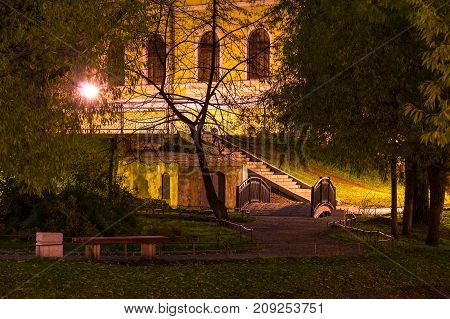 St. Petersburg, Russia - October 29, 2016: Night view of park and facade of State University of Communication in Yusupov Garden