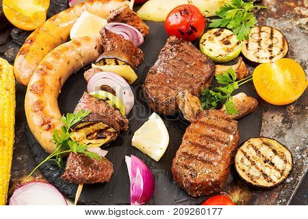 Assorted Delicious Grilled Barbecue Meat With Vegetable. Beef Grilled Steaks With Spicy Sausages, Be