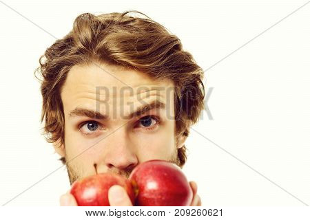 Man With Attentive Gaze On Red Apples In His Hand