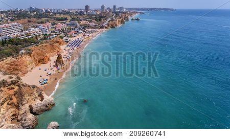 Aerial. Rocks and beaches near the beaches of Portimao.