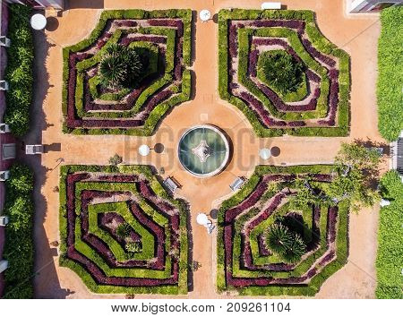 Ornamental garden with a fountain. Shot a dron from above.