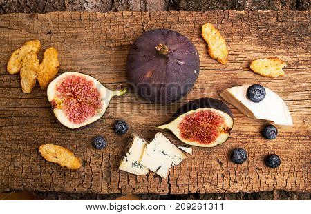 Figs, Half Of Figs, Brie And Blue Cheese On Old Wooden Background. Dieting Healthy Eating Concept. T
