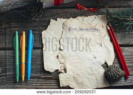 A Letter To Santa Claus On Wooden Background With Branches Of Christmas Tree
