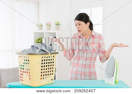 Elegant Female Student Looking At Messy Clothing