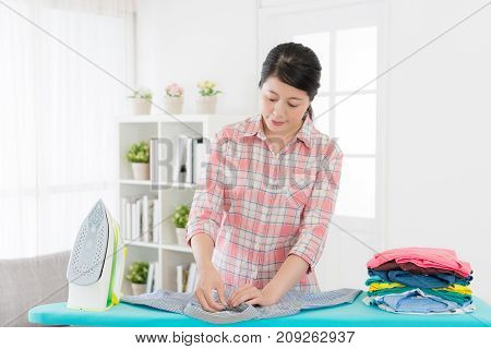 Pretty Woman Worker Ironing All Wrinkled Clothing