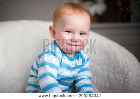 Redheaded baby boy with atopic dermatitis portrait