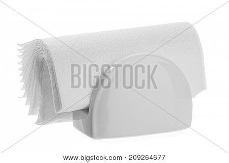 White napkin holder with napkins isolated on white background.