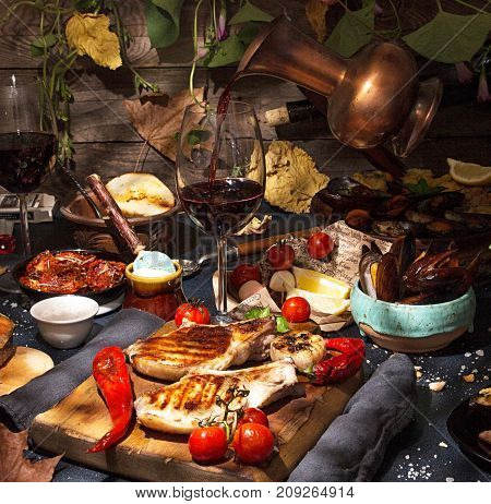 Overhead Of Dinner Table. Assorted Grilled Barbecue Meat And Seafood With Vegetable. Pork Grilled St