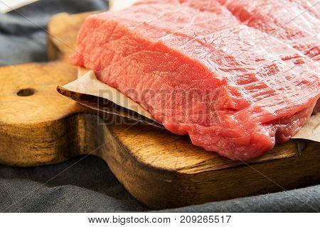Overhead Of Beef Steaks On Wooden Cutting Board. Slices Of Beef. Beef Tenderloin. Cooking Dinner.