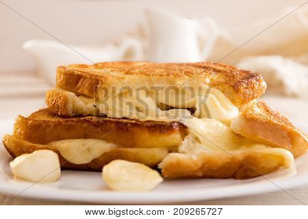 Italian Toast Sandwich With White Bread And Mozzarella Cheese Fried In Oil. Mediterranean Meal.