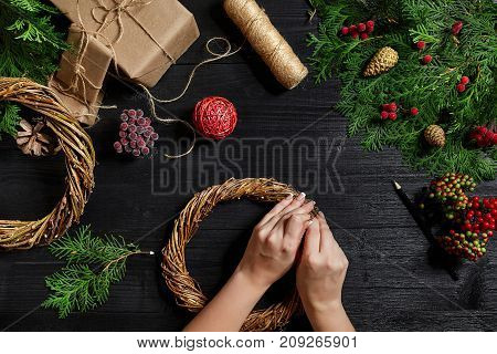Manufacturer of Christmas decor with their own hands. Christmas wreath for the holiday. The new year celebration. Master class on making decorative ornaments. Top view. Flat lay