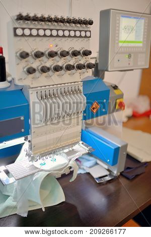 Textile weaving machine in factory, close up