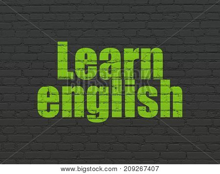 Studying concept: Painted green text Learn English on Black Brick wall background