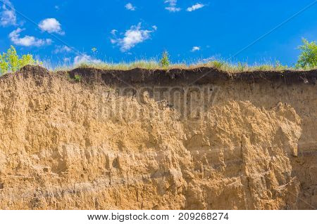 Wall of earth in section in an open clay pit in central Ukraine