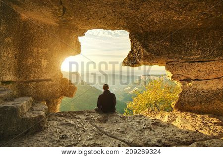 Man in cave mountain. Conceptual scene.