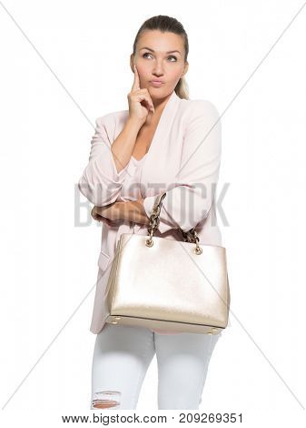 Portrait of a thinking adult woman posing over white background