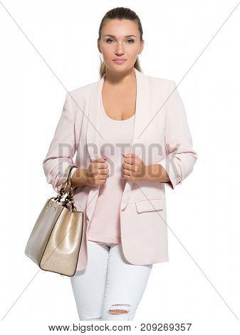 Portrait of an young  woman with handbag posing at studio