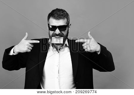 Business And Success Concept. Man With Dark Beard In Suit