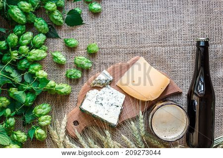 Beer background. Fresh beer and the salty cheese on a table. Top view. Still life. Flat lay.