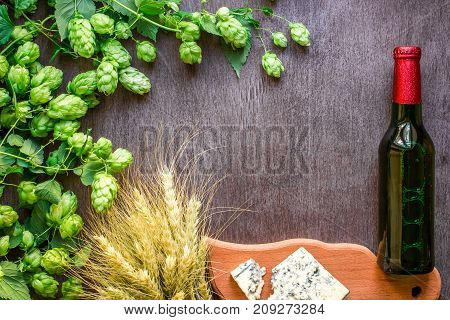 Beer background. Fresh beer and the salty cheese on a wooden table. Top view. Still life. Copy space. Flat lay.