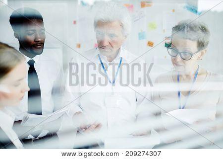 Team of successful investigators discussing new crime in office
