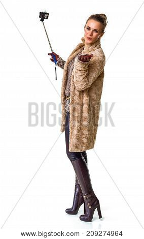 Fashion-monger On White With Selfie Stick Blowing Air Kiss