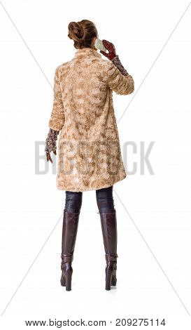 Trendy Woman In Winter Coat On White Speaking On Mobile Phone