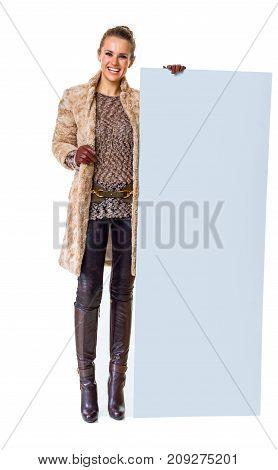 Happy Trendy Woman In Winter Coat On White Showing Blank Board