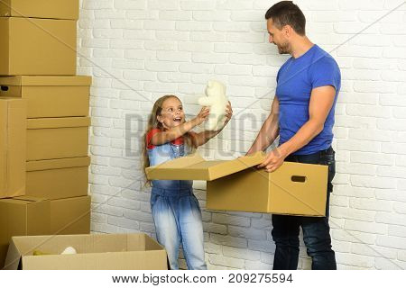 New Home And Family. Girl And Man With Happy Faces