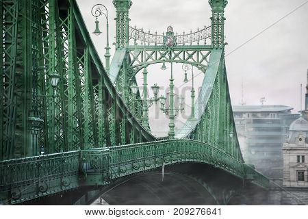 Foggy view of iron bridge over river in Budapest
