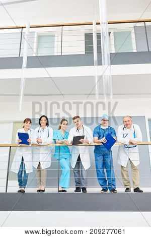Group of young and senior doctors in clinic before surgery