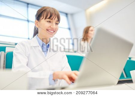 Young student as medicine apprentice study with laptop in medical school