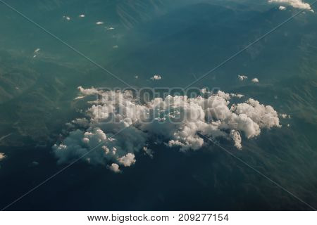 Beautiful cloud cumulus view from above over mountain background